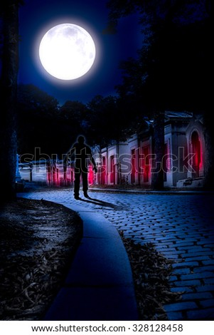 Cemetery Halloween background with graves and walking zombie  - stock photo