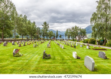 Cemetery in Norway, lake, clouds