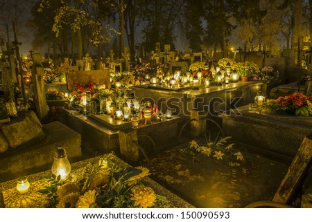 Cemetery in Poland on All Saints Day illuminated with candles