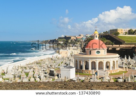 Cemetery on the coast in Old San Juan with colorful dome - stock photo