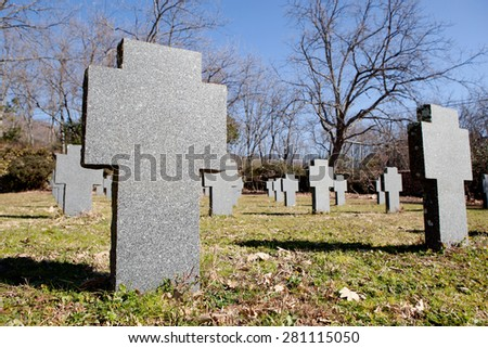 Cemetery with crosses in the same gray autumn - stock photo