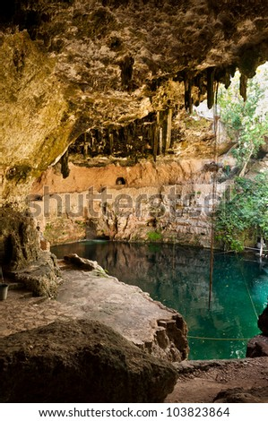 Cenote Zaci in Valladolid Mexico on Yucatan peninsula. A natural limestone sinkhole where people swim in the middle of the city. - stock photo