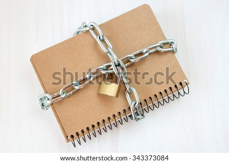 Censorship  concept, notepad with chain and padlock - stock photo