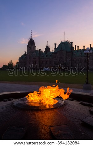Centennial Flame & Peace Tower in Parliament building complex Ottawa - stock photo