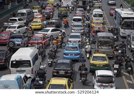 CENTER, BANGKOK, THAILAND - SEPTEMBER 2016: Busy traffic jam with cars and buses, in Ratchadamri Road in central Bangkok.