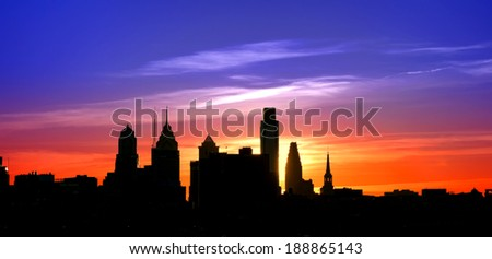 Center City Philadelphia scenic skyline cityscape silhouette with skyscraper buildings and historic landmarks with spectacular color sunset afterglow over colorful blue to orange sky