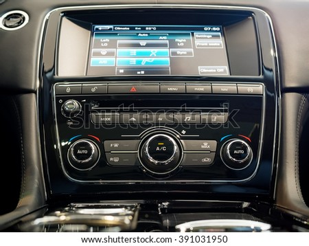 Center console and screen of a luxury car - stock photo