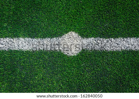 center line of a soccer grass field - stock photo