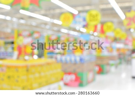 Center passage in super market discount at the blur background - stock photo