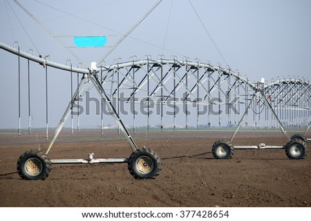 center pivot sprinkler system on field agriculture - stock photo