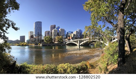 Center Street Bridge, Bow River with Skyline of Calgary, Alberta, Canada - stock photo
