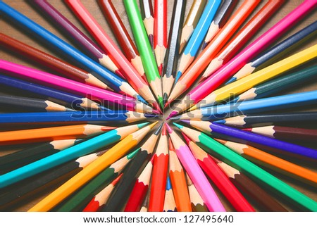 Center symbol of vector business team one goal, one aspiration and desire  bunch of colored pencils isolated on white background - stock photo