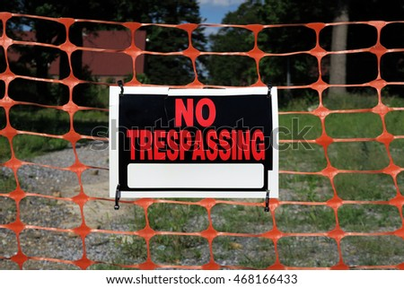 Centered image of a No trespassing sign on a hot summer day.