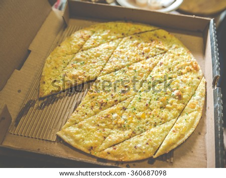 Centioli,a very thin,flat  pizza in the box. - stock photo