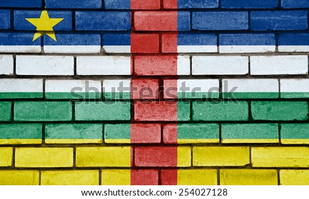 Central African Republic flag painted on old brick wall texture background - stock photo