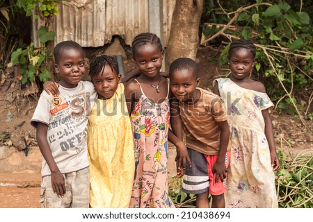 Central African Republic-July 17 unidentified boys and girls posing at streets of Bangui on July 17, 2014 in Bangui, Central African Republic - stock photo