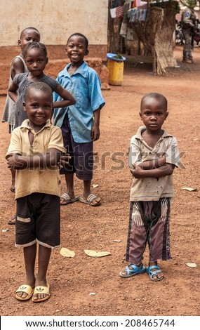 Central African Republic-July 17; unidentified poor kids at streets of Bangui on July 17, 2014 in Bangui, Central African Republic - stock photo