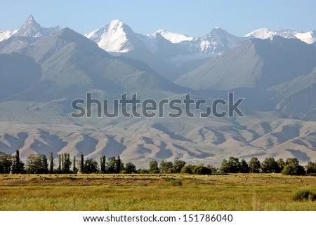 Central asia adventure travels: Karakul lake in Pamir highlands Tajikistan - stock photo