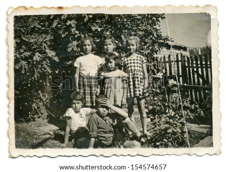CENTRAL BULGARIA, BULGARIA,- CIRCA 1955: A group of children in a summer garden. Note: slight blurriness, better at smaller sizes - circa 1955