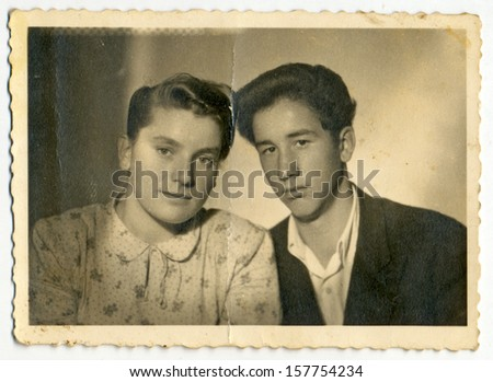 CENTRAL BULGARIA, BULGARIA - CIRCA 1950 - Common portrait of young woman and young man (lovers) - Note: slight blurriness, better at smaller sizes - circa 1950 - stock photo