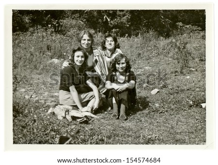 CENTRAL BULGARIA, BULGARIA,- CIRCA 1965: Four young women, friends, sitting in nature. Note: slight blurriness, better at smaller sizes - circa 1965