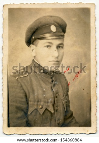 CENTRAL BULGARIA, BULGARIA - CIRCA 1950: Ordinary photo of an unknown young soldier - Note: slight blurriness, better at smaller sizes - circa 1950