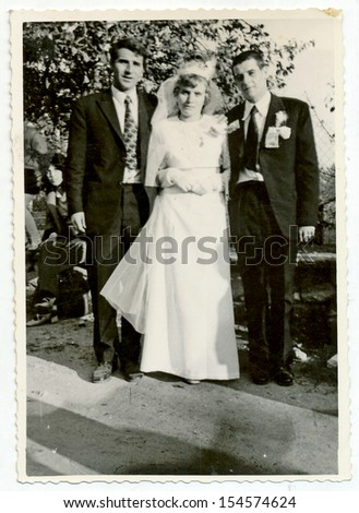 CENTRAL BULGARIA, BULGARIA,- CIRCA 1975: the area Plovdiv - Wedding photo of bride and groom with a friend. Note: slight blurriness, better at smaller sizes - circa 1975 - stock photo