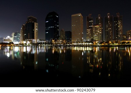 Central business district looking from lake at night, Bangkok Thailand.