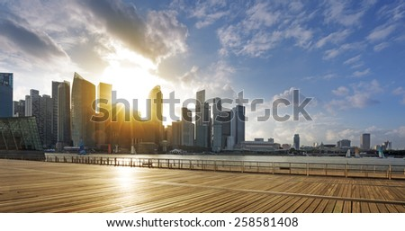 Central business district of Singapore and promenade at sunset - stock photo