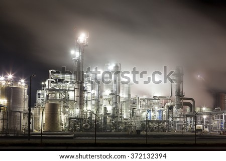 Central California, USA - November 13, 2011: Smoke and steam from smokestacks covering industrial machinery at a processing plant in Central California