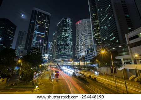 Central District Hong Kong - Feb 3, 2015: Modern business buildings in Central District of Hong Kong. Buildings are skyscrapers, stunning night view and skyline for Hong Kong. - stock photo