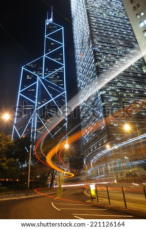 Central District Hong Kong - June 8, 2014: Bank of China Tower and Cheung Kong Center in Central District of Hong Kong. Both buildings are skyscrapers, stunning night view and skyline for Hong Kong.  - stock photo