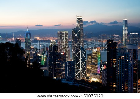 Central district skyscrapers at sunset, Hong Kong Island - stock photo