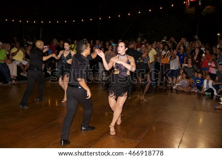 CENTRAL FALLS, RHODE ISLAND-JULY 29: A couple dance the salsa at an outdoor dance party on July 29, 2016 in Central Falls, Rhode Island