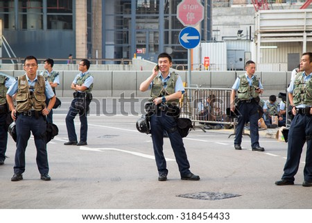 Central Government Offices, Hong Kong - September 23, 2014: 2014 Hong Kong class boycott campaign. Police officer are standing in front of protesters.