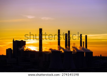 Central heating and power plant on beautiful colorful sunset background - stock photo