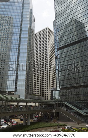 CENTRAL, HONG KONG - MAY 2016: Connaught Road Central with closeup of office towers and pedestrian flyover - financial district of the city, downtown Hong Kong, China.
