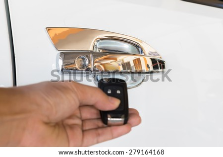 Central Lock unlock button on car remote control unlocks door alarm systems. Vehicle convenience safety security system. - stock photo