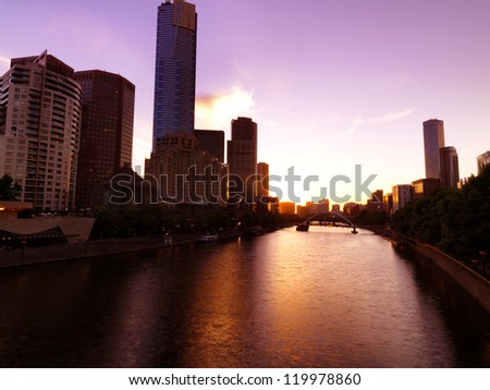 Central Melbourne across the Yarra river on sunset - stock photo