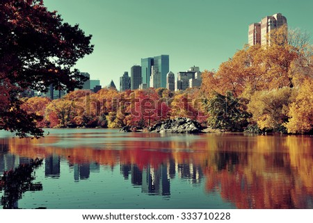 Central Park Autumn and buildings reflection in midtown Manhattan New York City - stock photo