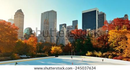 Central Park Autumn ice rink midtown skyline in Manhattan New York City - stock photo