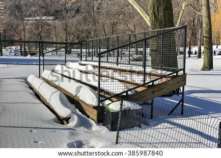 Central Park baseball stand covered in snow.