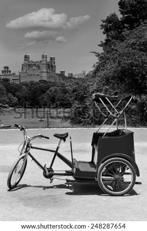 Central Park Manhattan The Lake rickshaw bike New York US - stock photo