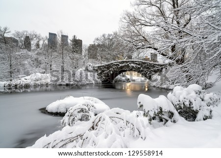 Central Park, New York City at Gapstow bridge in the early morning after snow storm - stock photo