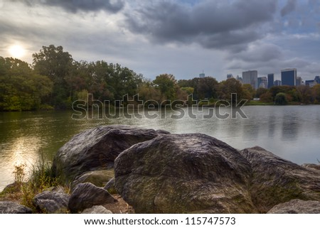 Central Park, New York City at the lake at sunset with oninous clouds