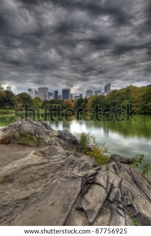 Central Park, New York City by the lake in early autumn - stock photo