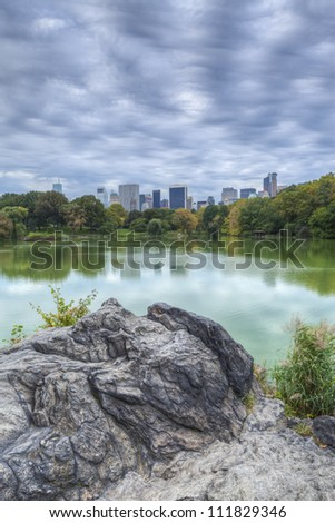 Central Park, New York City citiscape on lake on stone ridge