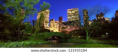 Central Park panorama with Manhattan skyline at dusk, New York City - stock photo
