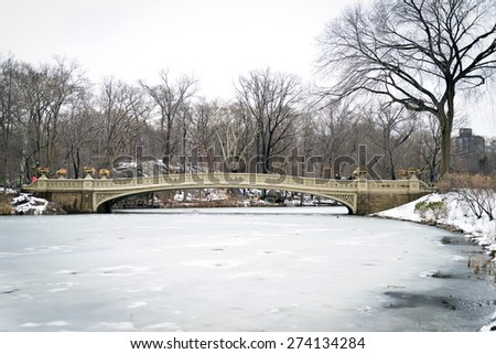 Central Park's Bow Bridge in winter, the oldest bridge in New York City, was completed in 1862