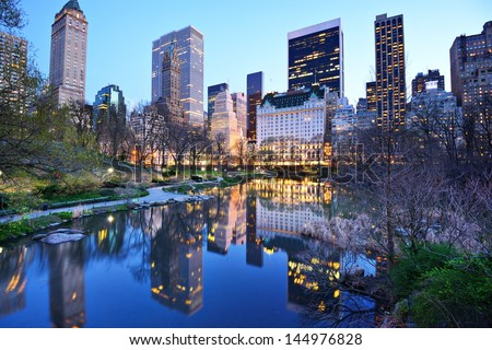 Central Park South skyline from Central Park Lake in New York City. - stock photo